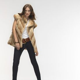 Beige beaver sheared fur jacket with Kalgan lamb trim.